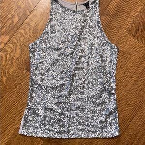 Silver sequin tank. Wear alone or underneath! 🔥